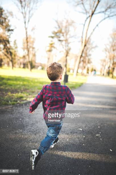 running in the sun - runaway stock pictures, royalty-free photos & images