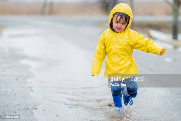 running in water - boots over pants stock photos and pictures