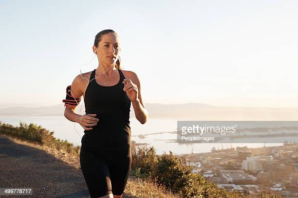 running is a way of life - one young woman only stock pictures, royalty-free photos & images
