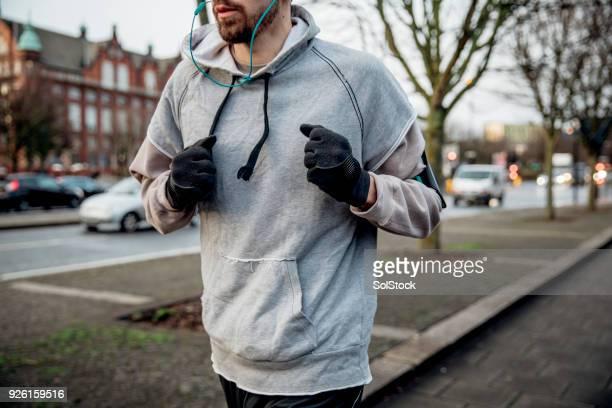 ランニングは彼に合う - 手袋 ストックフォトと画像