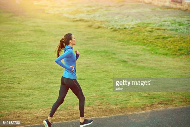 running makes your whole body work - long sleeved stock photos and pictures