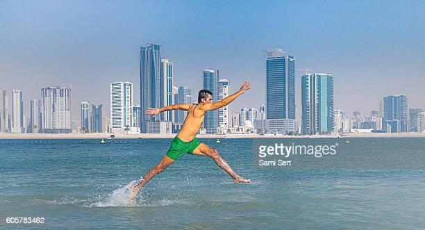Running man in sea water