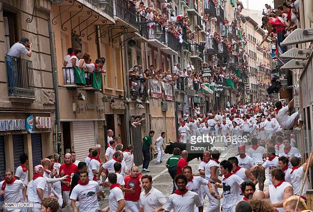 running of the bulls during festival of san fermin in pamplona - pamplona stock photos and pictures