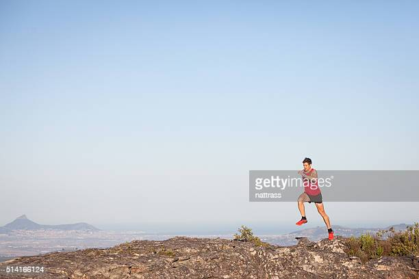 running on a mountain - striding stock pictures, royalty-free photos & images