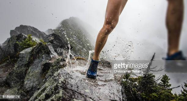 running on mountain ridge in puddle - cross country running stock pictures, royalty-free photos & images