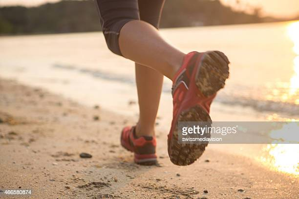 running on the beach at sunset - stepping stock pictures, royalty-free photos & images