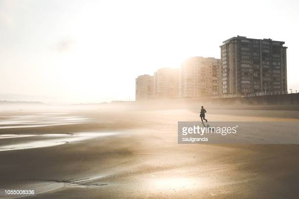 running on the beach in the morning - sporting term stock pictures, royalty-free photos & images