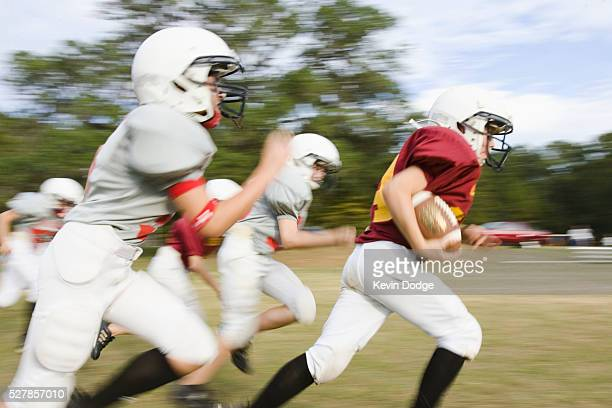 running on the football field - rush american football stock pictures, royalty-free photos & images