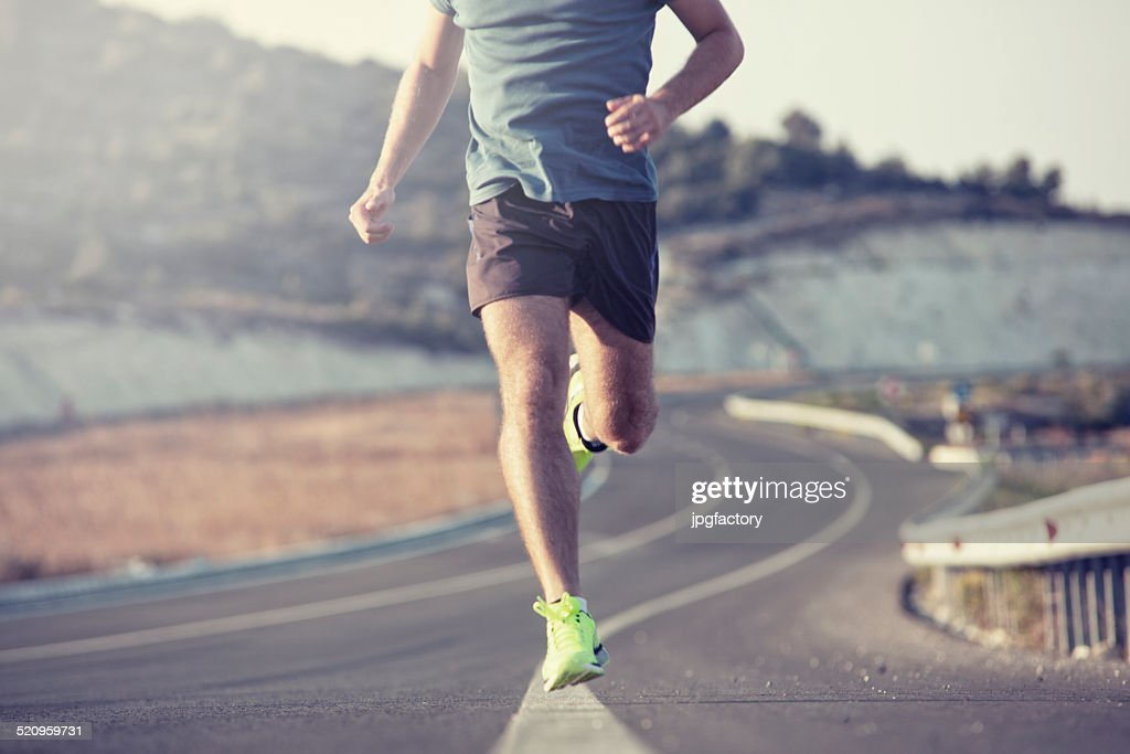 running outdoor on asphalt road : Stock Photo