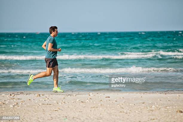 running outdoor on beach - men bulges stock photos and pictures
