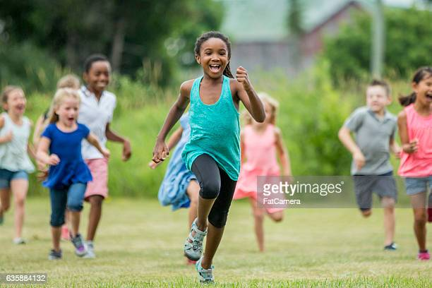 running outside at recess - kids playing tag stock photos and pictures