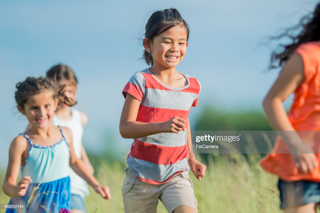 Running Outside at Recess : Stock Photo
