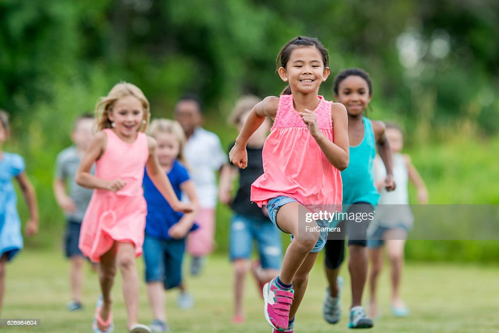 Running Outside During Recess : Stock Photo