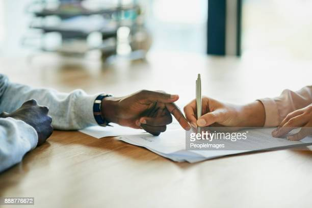running over the terms and conditions in her contract - agreement stock pictures, royalty-free photos & images
