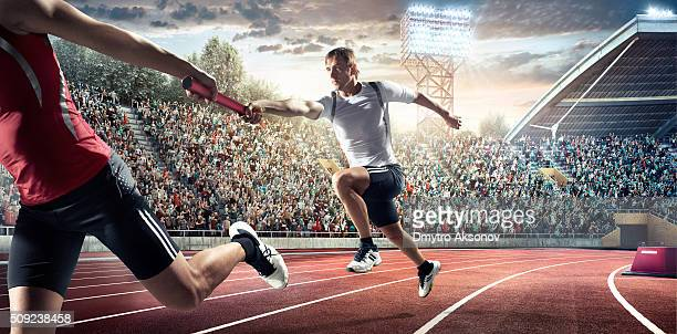 running pass on . stadium - athleticism stock pictures, royalty-free photos & images