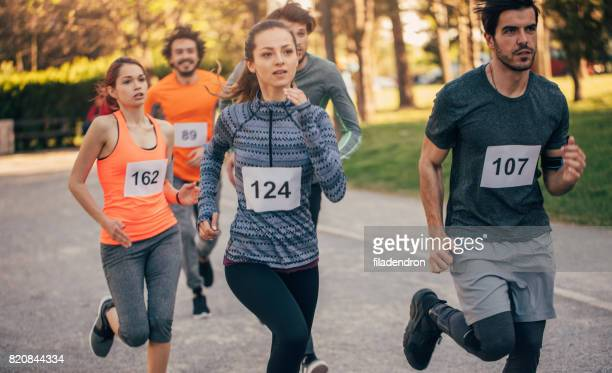 running race - marathon stock pictures, royalty-free photos & images