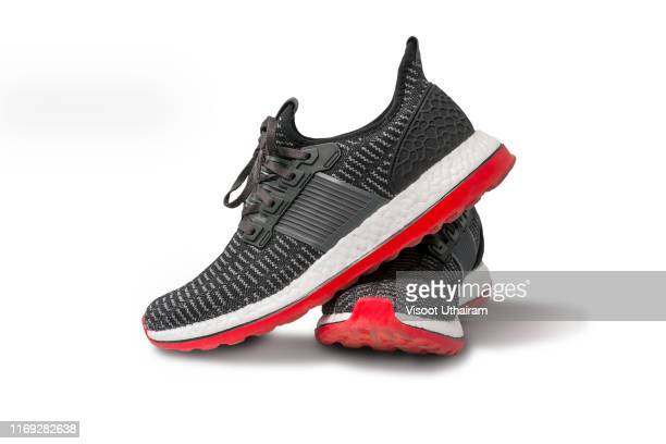 running shoe isolated on white background. - sports shoe stock pictures, royalty-free photos & images