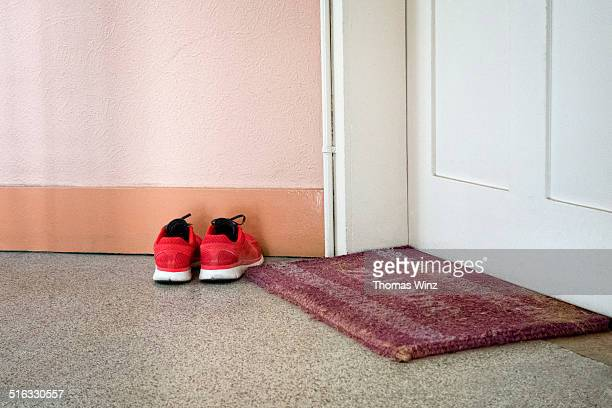 Running shoes and door mat
