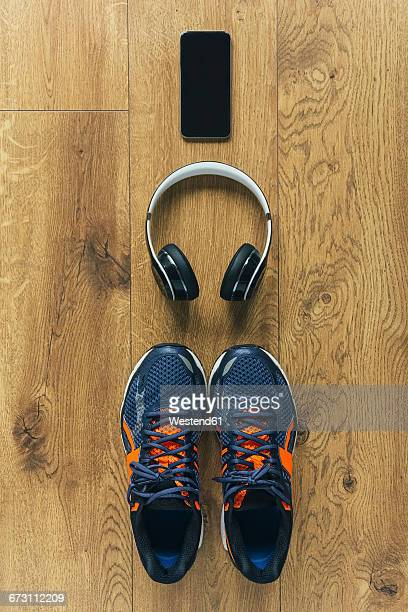 Running shoes, headphones, smartphone
