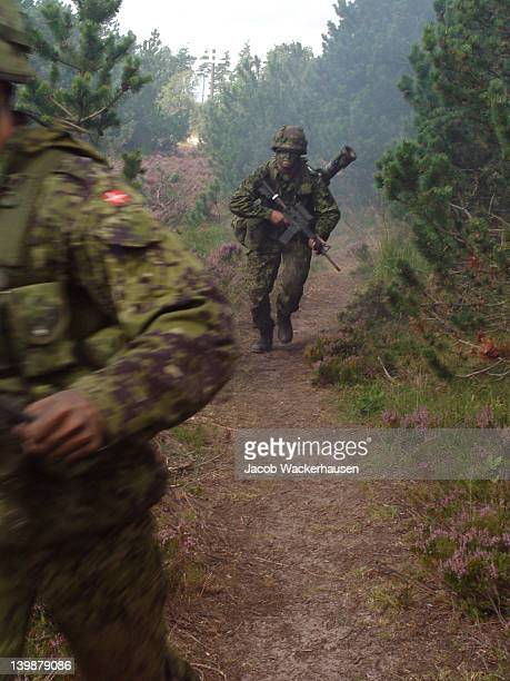 running soldier with soft focus and motion blur. - army training stock pictures, royalty-free photos & images