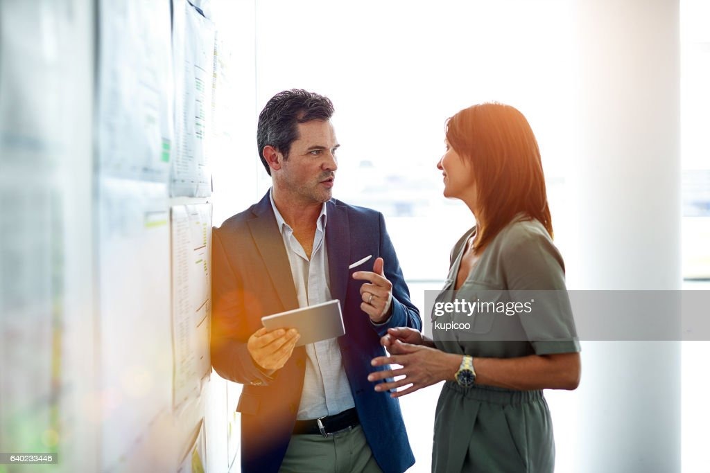 Running some ideas by a colleauge : Stock Photo