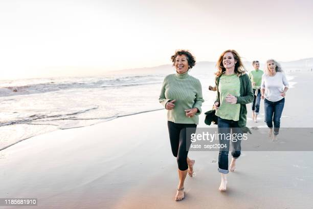 running support senior group - kate green stock pictures, royalty-free photos & images