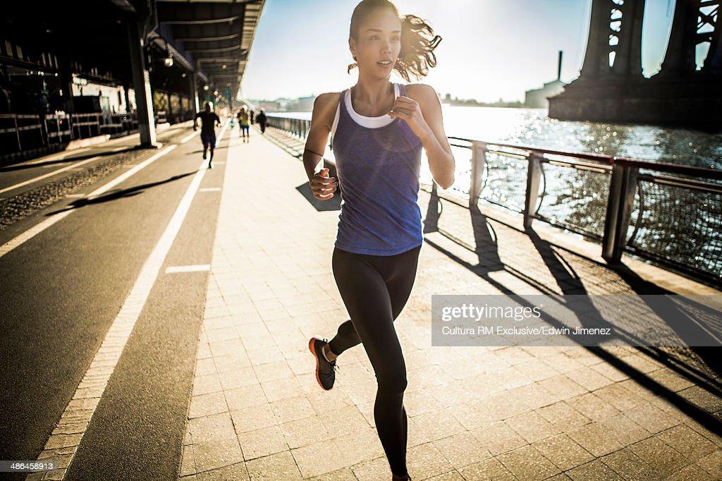 Running team, running under bridge, New York, USA : Stock Photo
