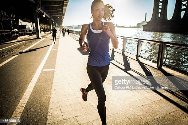 Running team, running under bridge, New York, USA