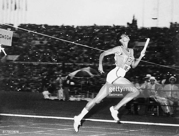 Running the anchor leg, American Wilma Rudolph crosses the finish line to win the women's 400-meter relay at the 1960 Summer Olympics in Rome. The...
