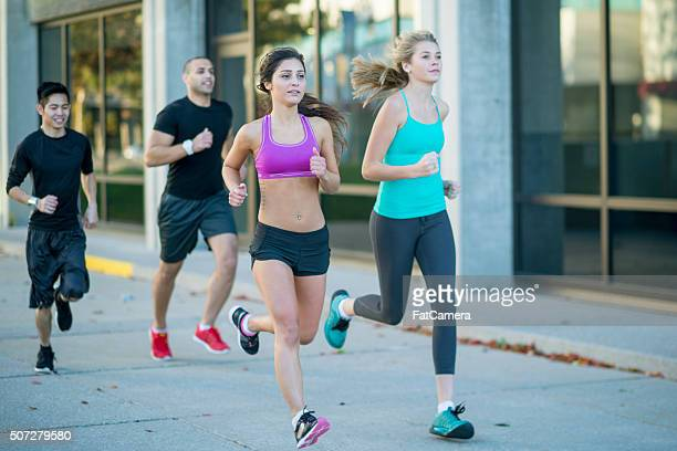 running through the city - women wearing spandex stock photos and pictures