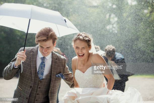 running through the rain - wedding stock pictures, royalty-free photos & images