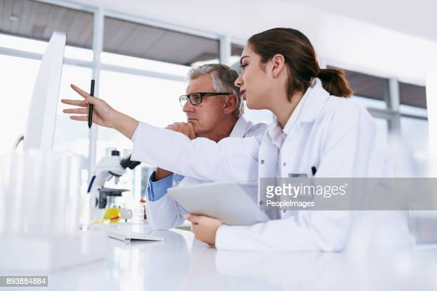 running through their latest findings - science and technology stock pictures, royalty-free photos & images