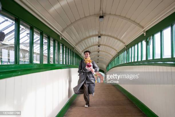 running to a date - charming stock pictures, royalty-free photos & images