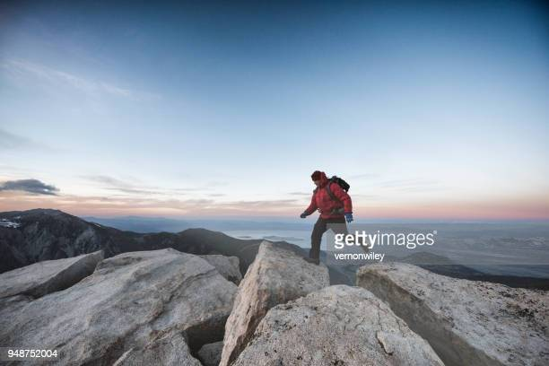 running to summit - at the edge of stock photos and pictures