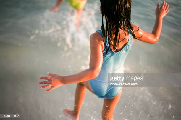 running to swim - one piece swimsuit stock pictures, royalty-free photos & images
