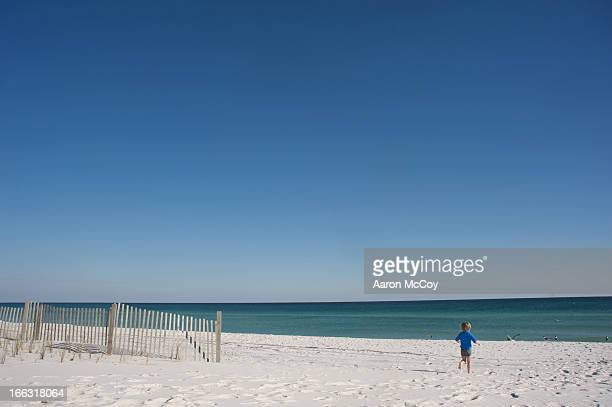 running to the sea - pensacola beach stock pictures, royalty-free photos & images
