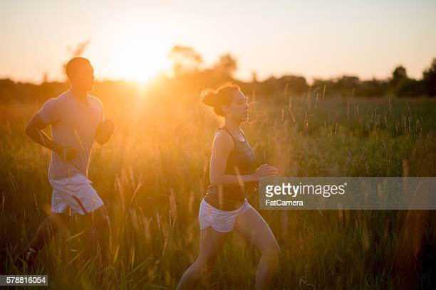 Running Together at Sunset