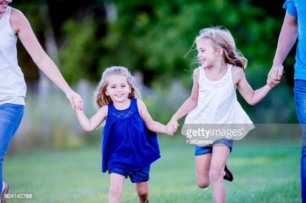 running together - skipping along stock pictures, royalty-free photos & images