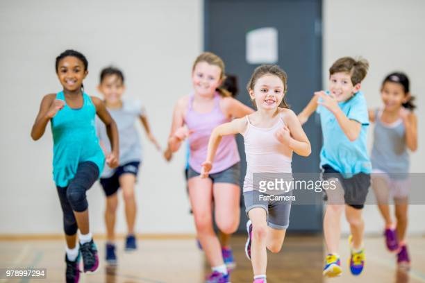 running together - physical education stock pictures, royalty-free photos & images