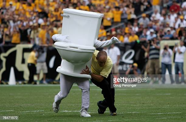 A running toilet is stopped as part of a promotion by Denver Water during a break in the action as the Colorado Buffaloes defeated the Colorado State...