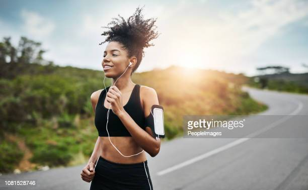 running towards a healthier and happier lifestyle - healthy lifestyle stock pictures, royalty-free photos & images