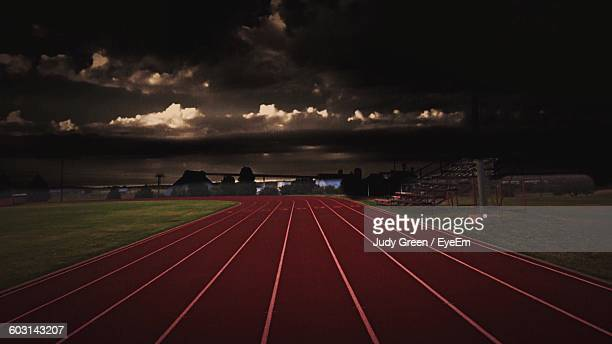 running track against overcast sky - all weather running track stock pictures, royalty-free photos & images