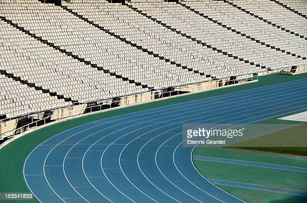 running track curves and empty bleachers in sport stadium - track and field stadium stock pictures, royalty-free photos & images