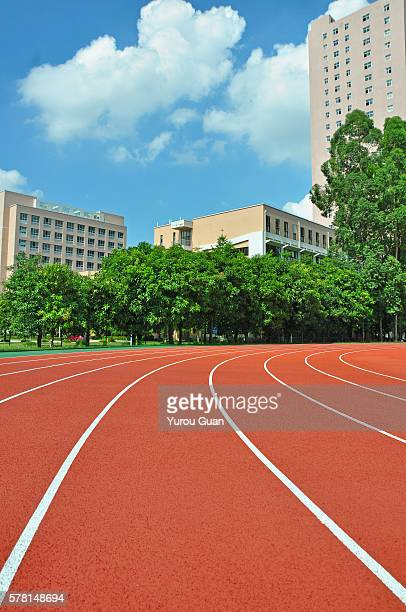 Running track over trees and clouds.