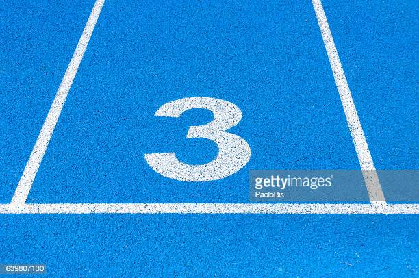 Running track with numbered lanes