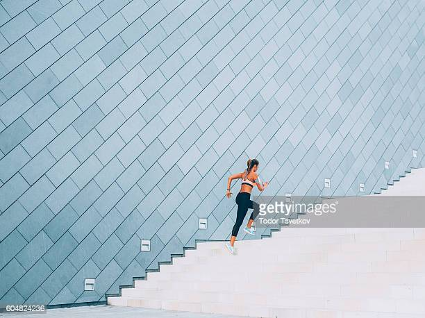 running up the stairs - endurance stock photos and pictures