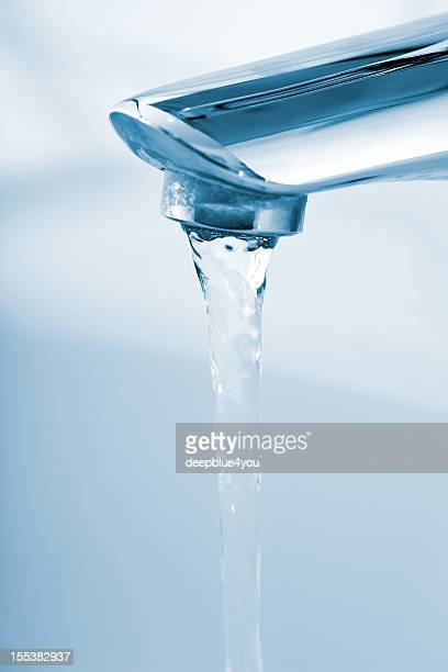 running water from bathroom faucet - das leben zu hause stock pictures, royalty-free photos & images