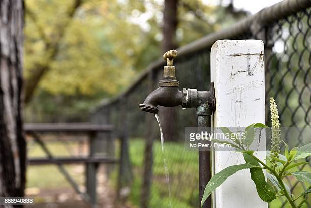 Running Water From Faucet By Fence
