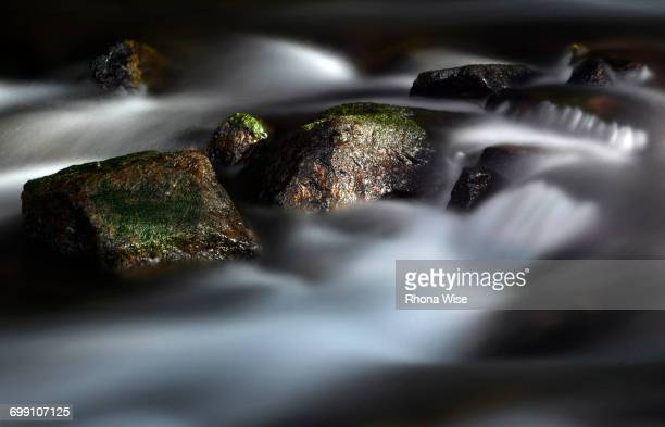 running water in a stream - maroon bells stock photos and pictures