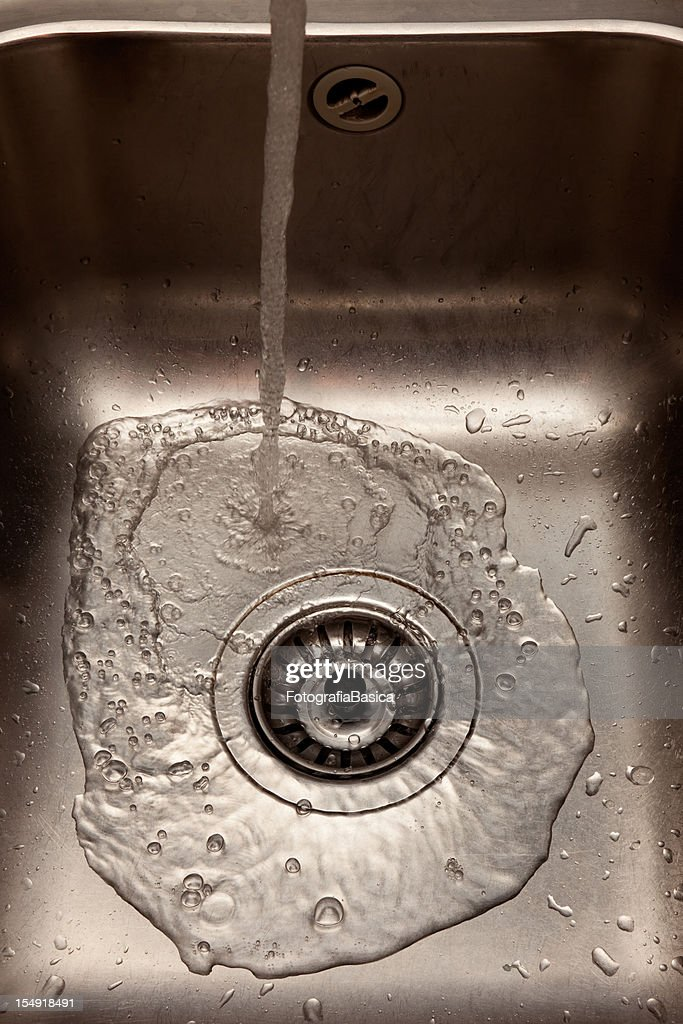 Running Water In Kitchen Sink High Res Stock Photo Getty Images